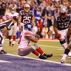 Ahmad Bradshaw tries to stop himself from falling into the end zone but his forward momentum carries him in during New York's 21-17 victory.
