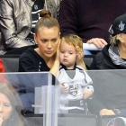 The actress appears to be shielding her son's tender ears from the hoary oaths and epithets of the hockey players at Staples Center, where the hometown Kings got crowned by the Blackhawks in their season-opener.