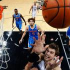 The New Orleans Hornets' Anthony Davis and the San Antonio Spurs' Tiago Splitter battled for a rebound in the first quarter of a Jan. 23 matchup. Splitter led all scorers with 25 points to propel San Antonio to a 106-102 victory.