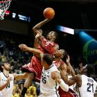 Washington State guard Mike Ladd gets the offensive rebound and the put-back as he rises above Oregon's Arsalan Kazemi, Tony Woods and Damyean Dotson. Ladd's 14 first-half points helped give the Cougars a 10-point lead at halftime, but Oregon stormed back to win 68-61.