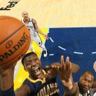 Ian Mahinmi gets above Marreese Speights for a layup in the Indiana Pacers-Memphis Grizzlies Jan. 21 matchup. Mahinmi's Pacers pulled out an 82-81 win when George Hill made a free throw with 1.4 seconds remaining.