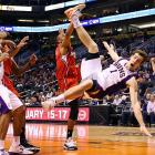 Phoenix Suns center Marcin Gortat falls after receiving a hard foul from Los Angeles Clippers small forward Caron Butler in the second half of the Suns' 93-88 win on Jan. 24. Gortat scored 15 points with eight rebounds in the victory.