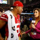 Clark Haggans of the 49ers gets quizzed by Katherine Webb.