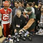 """San Francisco 49ers cornerback Chris Culliver takes a seat to answer questions regarding anti-gay remarks he made during media day. Culliver apologized for the comments he made to a comedian during an interview, saying """"that's not what I feel in my heart."""""""