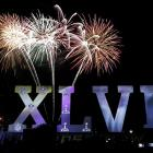 Fireworks explode as the NFL Super Bowl XLVII Roman numerals float on the Mississippi River Thursday.