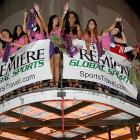 The Premiere Girls can be seen throwing beads off the balcony at the Premiere Global Sports Balcony Over Bourbon Party in New Orleans.