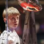 Stefan Schexnayder, 8, gets a close up look of the Vince Lombardi Trophy on display at the NFL Experience.
