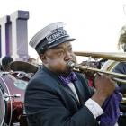 Richard Anderson, of New Orleans, plays the trombone as the Kinfolks Brass Band marches along the Riverwalk in New Orleans.
