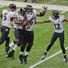 The Ravens celebrate after putting the first points on the board.