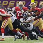 Paul Kruger and the Ravens kept Colin Kaepernick under control in the first half. He finished the game with 62 yards rushing and one touchdown and passed for 302 yards and another TD.