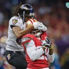 Wideout Torrey Smith of the Ravens turns into a defender to try to keep Chris Culliver from making an interception.