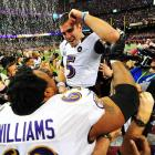 Quarterback Joe Flacco celebrates with guard Bobbie Williams amid a swarm of media after the Baltimore Ravens defeated the San Francisco 49ers 34-31 in Super Bowl XLVII. Flacco was named Super Bowl MVP for his 287-yard, three-touchdown performance.