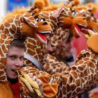 "You can't make this stuff up, so we won't. Just read the official caption and try not to feel like you've ingested LSD: ""Carnival revellers dressed as giraffes eat a sausage while they celebrate the start of the street carnival with its tradition of fools entering the town halls and women cutting off men's ties with scissors on so-called Old Women's Day in Cologne, Germany. Old Women's Day is traditionally the beginning of street carnival, with the foolish street spectacles in the carnival centers of Duesseldorf, Mainz and Cologne."" Has a certain logic to it, right?"