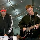 Bob Bryan plays the keyboard, with his brother Mike on guitar, at the Tennis Masters Cup at the Qi Zhong Stadium on Nov. 16, 2005 in Shanghai, China.