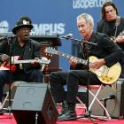 The tennis great plays the guitar along with music legend Bo Diddley before the US Open on Aug. 29, 2005, in Flushing Meadows, NY.