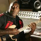 "The defensive tackle/end plays bass guitar at his music studio, ""Outlook Music,"" in Denver on April 26, 2005."