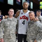 Tyson Chandler poses with members of the Armed Forces during the National Team Open Practice at the DC Armory in 2012.