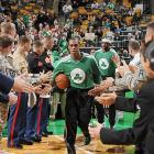 Rajon Rondo high fives soldiers before a 2013 game against the Charlotte Bobcats.