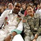 Actor Chris Tucker poses with a soldier on Seats for Soldiers night during a 2009 game between the Magic and the Hawks.