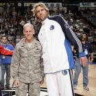 Mavericks forward Dirk Nowitzki poses with a member of the Air Force before a 2009 game against the Warriors.