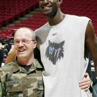 Kevin Garnett with a member of the 934th Airlift Wing as part of the Timberwolves' 2004 Operation Minnesota Heroes, a program honoring and recognizing Minnesota troops that served in the Middle East.