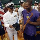 Kobe Bryant receives some Navy momentos from Chief Petty Officer Lawrence Sivils following Sivils' 2005 reenlistment ceremony at which Bryant assisted as a witness.