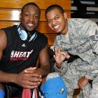 Dwyane Wade smiles with a soldier after a training camp practice in 2010 at Aderholt Gym in Hurlburt Field, Fla.