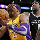 """That's not a game of """"Guess Who"""" Brooklyn's Andray Blatche is playing with Dwight Howard of the Lakers."""