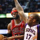 Richard Hamilton of the Bulls almost gets unmasked by P.J. Tucker of Phoenix.