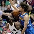 New Orleans Hornets' Robin Lopez clobbers Al Jefferson of Utah.
