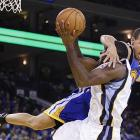 Quincy Pondexter of the Grizzlies gets a midair arm from Stephen Curry of Golden State.