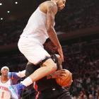 Tyson Chandler of the Knicks tries to hurdle LeBron James of the Heat. He didn't make it.