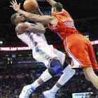 Oklahoma City forward Kevin Durant gets a flying arm in the face from Clippers center Ryan Hollins.