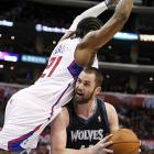 The Clippers' Ronny Turiaf's Superman impression ends with a foul on Minnesota's Kevin Love.