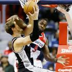 Martell Webster of the Washington Wizards misses the ball and gets only face as he fouls Tiago Splitter of San Antonio.