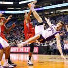 Goran Dragic of Phoenix makes like a sinking Sun after being fouled by Caron Butler of the Clippers.