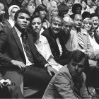 Buss sits at a Lakers game with Muhammad Ali and Los Angeles Mayor Tom Bradley at The Forum, the former home of the Lakers.