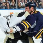 Buffalo Sabres center Cody McCormick fights Pittsburgh Penguins left winger Tanner Glass in the third period of a Feb. 17 NHL game. The Penguins defeated the Sabres 4-3 behind two goals from Pascal Dupuis.