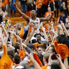 Oklahoma State guard Markel Brown celebrates with fans after the Cowboys' 84-79 victory over Oklahoma on Feb. 16. Oklahoma State rallied from an 11-point deficit in the second half to defeat the rival Sooners, led by a combined 54 points from Marcus Smart and Le'Bryan Nash.