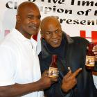 A former heavyweight champ can work up a man-sized thirst, so that's why these two pugs always carry a flask of Holyfield's Real Deal barbecue sauce.