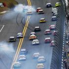 Jamie McMurray, driver of the #1 McDonald's Chevrolet, Kevin Harvick, driver of the #29 Budweiser Chevrolet, and Brad Keselowski, driver of the #2 Miller Lite Ford, are involved in an incident.