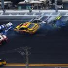 Carl Edwards (99), Trevor Bayne (21), and David Gilliland (38) get caught up in an accident.