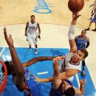 Los Angeles Clippers power forward Blake Griffin rises above two Oklahoma City Thunder defenders in a March 3 game at the Staples Center in Los Angeles. Griffin dropped in 20 points, but the Thunder held on after building a 13-point halftime lead to defeat the Clippers 108-104.