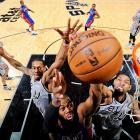 Detroit Pistons center Greg Monroe gets to the hoop as Kawhi Leonard and Tim Duncan of the Spurs reach for a block in a March 3 game in San Antonio. Leonard and Duncan combined for 30 points and were two of the four Spurs players with 14 points or more in San Antonio's 114-75 rout.