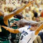 South Florida center Jordan Omogbehin catches Pitt guard James Robinson across the face while swiping at the ball in a Feb. 27 Big East matchup. Robinson took the blow but got the last laugh as the No. 23 Panthers easily dispatched the Bulls 64-44.