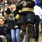 The Bruins' mascot and his comely companion can bearly contain their glee as the B's beat the Senators at TD Garden in Boston.
