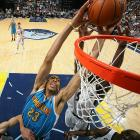 New Orleans Hornets power forward Anthony Davis stretches to the rim while Memphis Grizzlies shooting guard Tony Allen tries to deny him in a March 9 game in Memphis. Allen, who scored 14 points, was one of seven players in double figures for the Grizzlies as they defeated the Hornets 96-85.