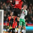 Rennes forward Julien Feret leaps for a header in front of Saint Etienne midfielder Fabien Lemoine in a French Ligue 1 match in Rennes. The game ended in a 2-2 draw after Pierre Emerick Aubameyang scored in the 65th minute to match Feret's goal in the 51st minute.