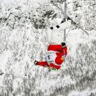 Patrick Deneen competes in the FIS Freestyle Ski World Championship moguls competition in Voss, Norway. The American scored a 25.9 on his run to take third place, while Mikael Kingsbury and Alex Bilodeau gave Canada a one-two finish.