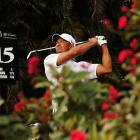 Tiger Woods admires his shot off the 15th tee at the WGC-Cadillac Championship at Doral Golf Resort on March 9. Woods liked what he saw all weekend as he shot 19-under for the tournament to win by two strokes.